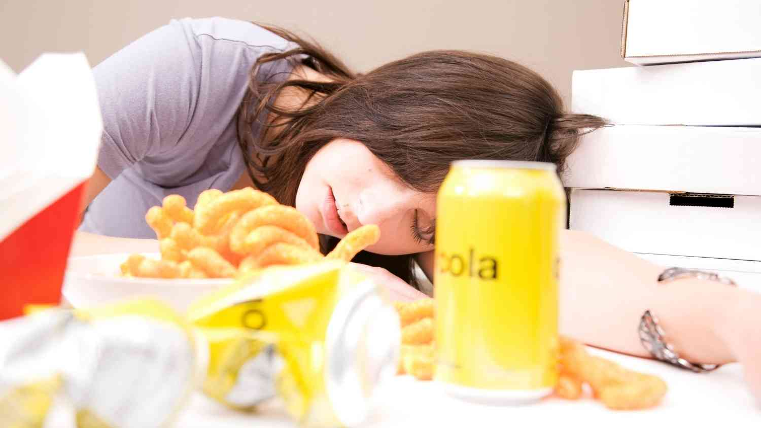 Woman sleeping on plate
