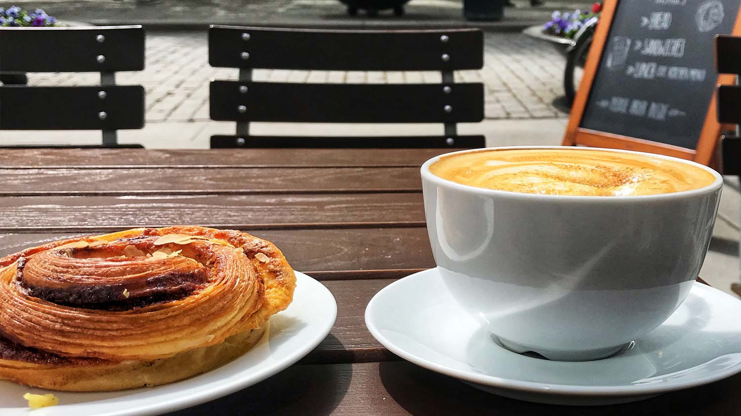 Pastry and coffee on table